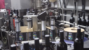 Labeling filled bottles